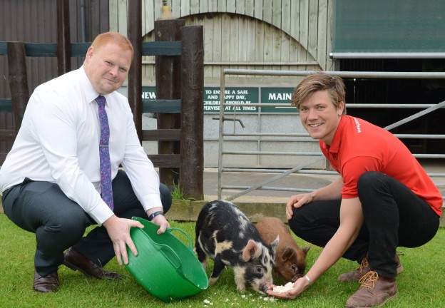Production Manager at Dragonfly foods, Gareth Burton with Pennywell's Angus Murray feeding Okara to the pigs